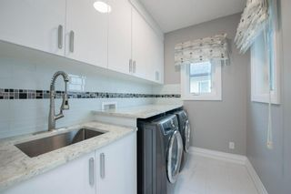 Photo 36: 48 Tremblant Terrace SW in Calgary: Springbank Hill Detached for sale : MLS®# A1131887