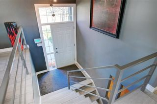 Photo 2: 204 MAPLE COURT Crescent SE in Calgary: Maple Ridge Detached for sale : MLS®# A1152517