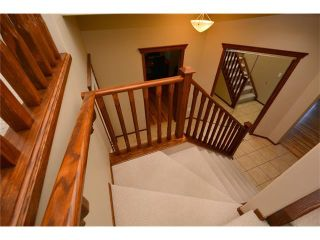 Photo 36: 112 WEST POINTE Manor: Cochrane House for sale : MLS®# C4116504