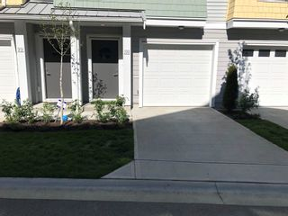 """Photo 1: 100 5550 ADMIRAL Way in Delta: Neilsen Grove Townhouse for sale in """"Fairwinds"""" (Ladner)  : MLS®# R2605291"""