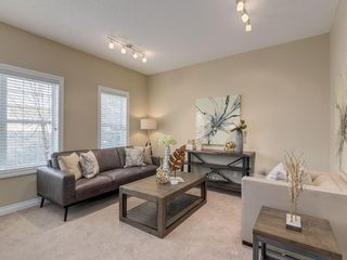 Photo 19: 81 Somme Boulevard SW in Calgary: Garrison Woods Residential for sale : MLS®# A1072185