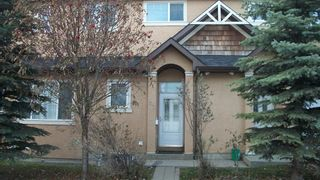 Photo 2: 147 23 Avenue NW in Calgary: Tuxedo Park Row/Townhouse for sale : MLS®# A1047875