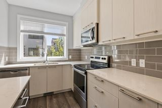 Main Photo: 810 Redstone Crescent NE in Calgary: Redstone Row/Townhouse for sale : MLS®# A1109002