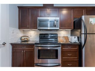 """Photo 9: 109 33338 MAYFAIR Avenue in Abbotsford: Central Abbotsford Condo for sale in """"The Sterling"""" : MLS®# R2558844"""