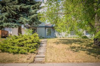 Photo 2: 12023 Candiac Road SW in Calgary: Canyon Meadows Detached for sale : MLS®# A1128675