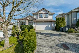 """Photo 1: 7710 145 Street in Surrey: East Newton House for sale in """"East Newton"""" : MLS®# R2563742"""