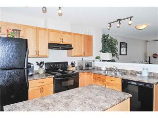 Photo 11: 318 TOSCANA Gardens NW in Calgary: Tuscany House for sale : MLS®# C4116517