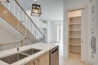 Photo 14: 244 21 Avenue NW in Calgary: Tuxedo Park Detached for sale : MLS®# A1016245
