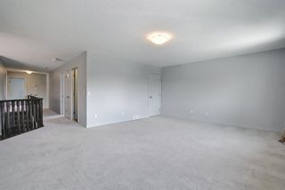 Photo 24: 61 Everhollow Green SW in Calgary: Evergreen Detached for sale : MLS®# A1115077