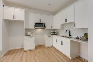 Photo 14: 249 Lucas Avenue NW in Calgary: Livingston Row/Townhouse for sale : MLS®# A1102463