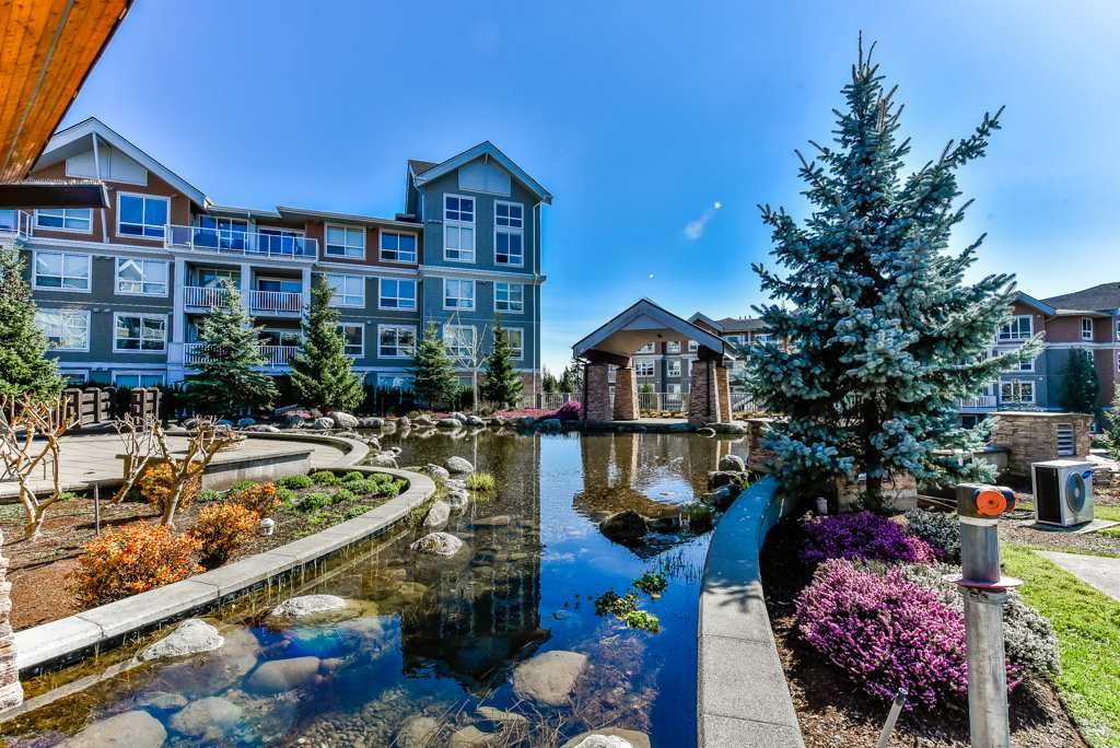 "Main Photo: 111 6480 194 Street in Surrey: Clayton Condo for sale in ""Waterstone"" (Cloverdale)  : MLS®# R2369841"