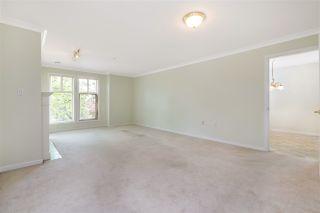 "Photo 4: 201 15350 19A Avenue in Surrey: King George Corridor Condo for sale in ""STRATFORD GARDENS"" (South Surrey White Rock)  : MLS®# R2465076"