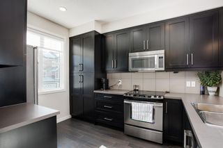 Photo 7: 25 Nolan Hill Boulevard NW in Calgary: Nolan Hill Row/Townhouse for sale : MLS®# A1073850