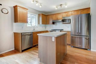Photo 8: 58 Covehaven View NE in Calgary: Coventry Hills Detached for sale : MLS®# A1122037