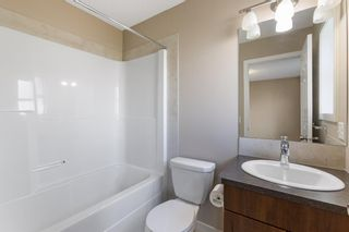 Photo 23: 122 Sunset Road: Cochrane Row/Townhouse for sale : MLS®# A1127717