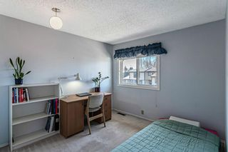 Photo 19: 1413 Ranchlands Road NW in Calgary: Ranchlands Row/Townhouse for sale : MLS®# A1133329