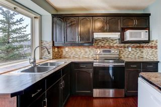 Photo 14: 101 Arbour Crest Road NW in Calgary: Arbour Lake Detached for sale : MLS®# A1136687
