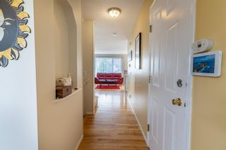 Photo 6: 112 Rocky Vista Circle NW in Calgary: Rocky Ridge Row/Townhouse for sale : MLS®# A1125808