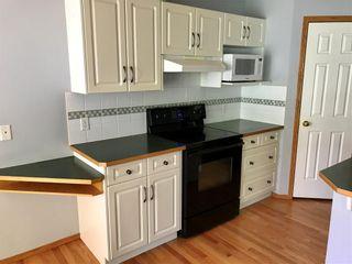 Photo 3: 20 DOUGLAS GLEN Heights SE in Calgary: Douglasdale/Glen House for sale : MLS®# C4109421