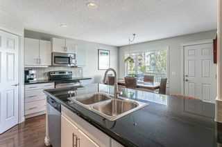 Photo 12: 232 Everbrook Way SW in Calgary: Evergreen Detached for sale : MLS®# A1143698