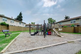 Photo 39: 77 123 Queensland Drive SE in Calgary: Queensland Row/Townhouse for sale : MLS®# A1145434