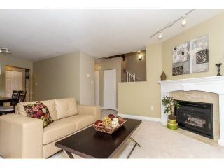 """Photo 1: 17 65 FOXWOOD Drive in Port Moody: Heritage Mountain Townhouse for sale in """"FOREST HILL"""" : MLS®# V1125839"""