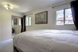 Photo 23: 24 GLAMIS Gardens SW in Calgary: Glamorgan Row/Townhouse for sale : MLS®# A1077235