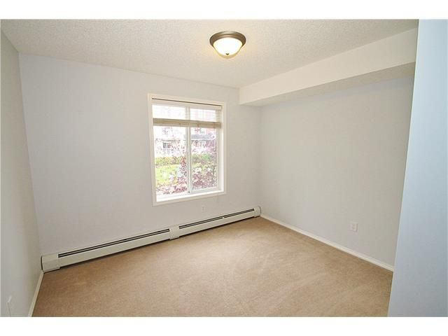 Photo 19: Photos: 4210 70 PANAMOUNT Drive NW in Calgary: Panorama Hills Condo for sale : MLS®# C4076260