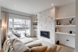 Photo 6: 1205 1 Street NE in Calgary: Crescent Heights Row/Townhouse for sale : MLS®# A1101476