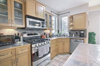 Photo 11: 34 Crestmont Drive SW in Calgary: Crestmont Detached for sale : MLS®# A1119055