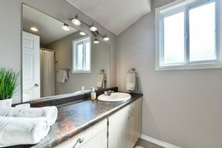 Photo 20: 1301 829 Coach Bluff Crescent in Calgary: Coach Hill Row/Townhouse for sale : MLS®# A1094909