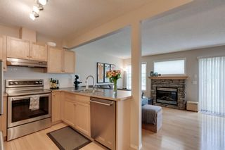 Photo 5: 11 Country Village Circle NE in Calgary: Country Hills Village Row/Townhouse for sale : MLS®# A1118288