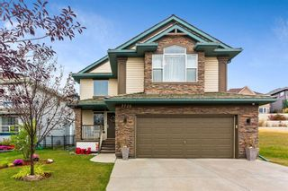 Photo 1: 7720 Springbank Way SW in Calgary: Springbank Hill Detached for sale : MLS®# A1043522