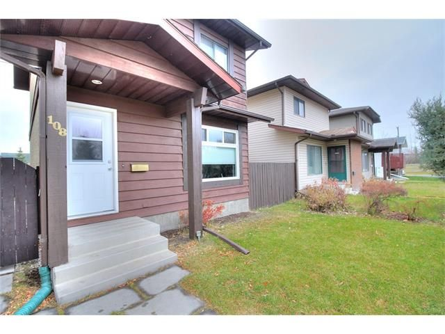 Photo 3: Photos: 108 SHAWGLEN Road SW in Calgary: Shawnessy House for sale : MLS®# C4038520