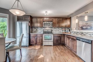 Photo 9: 61 Auburn Springs Boulevard SE in Calgary: Auburn Bay Semi Detached for sale : MLS®# A1135621