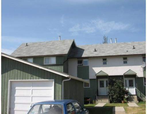 """Main Photo: 4 5320 MOUNTAINVIEW Drive in Fort_Nelson: Fort Nelson -Town Townhouse for sale in """"MOUNTAINVIEW CONDOS"""" (Fort Nelson (Zone 64))  : MLS®# N194745"""
