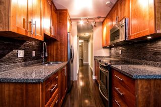 """Photo 2: 101 2615 LONSDALE Avenue in North Vancouver: Upper Lonsdale Condo for sale in """"HarbourView"""" : MLS®# V1078869"""