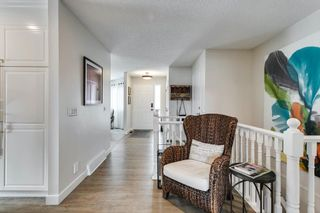 Photo 20: 84 Coach Side Terrace SW in Calgary: Coach Hill Semi Detached for sale : MLS®# A1077504