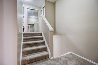 Photo 16: 1309 Ranchlands Road NW in Calgary: Ranchlands Row/Townhouse for sale : MLS®# A1060522