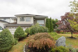 Photo 2: 8738 143A Street in Surrey: Bear Creek Green Timbers House for sale : MLS®# R2606825