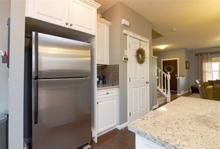 Photo 6: 160 CLYDESDALE Way: Cochrane House for sale : MLS®# C4137001