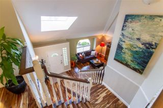 Photo 3: 20 FLAVELLE Drive in Port Moody: Barber Street House for sale : MLS®# R2437428