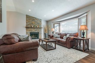 Photo 4: 884 Coach Side Crescent SW in Calgary: Coach Hill Detached for sale : MLS®# A1105957