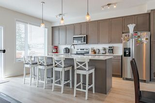 Photo 7: 145 Shawnee Common SW in Calgary: Shawnee Slopes Row/Townhouse for sale : MLS®# A1097036