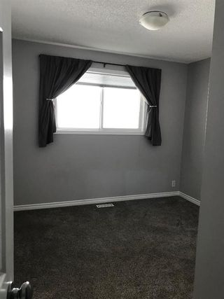 Photo 19: 35 Ranchlands Crescent NW in Calgary: Ranchlands Detached for sale : MLS®# A1115459