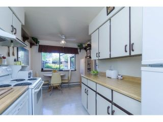 """Photo 6: 145 9455 PRINCE CHARLES Boulevard in Surrey: Queen Mary Park Surrey Townhouse for sale in """"Queen Mary Park"""" : MLS®# F1440683"""