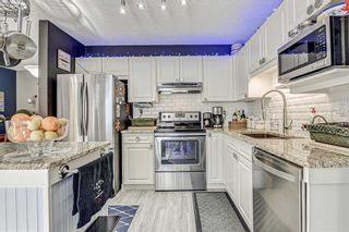 Photo 7: 183 Mt Douglas Manor SE in Calgary: McKenzie Lake Row/Townhouse for sale : MLS®# A1071755