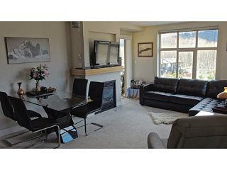 """Photo 4: 411 1211 VILLAGE GREEN Way in Squamish: Downtown SQ Condo for sale in """"ROCKCLIFFE"""" : MLS®# V1097477"""