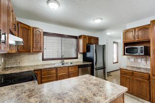 Photo 8: 219 Sandstone Drive NW in Calgary: Sandstone Valley Detached for sale : MLS®# A1112280