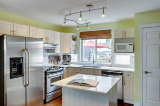 Photo 15: 246 Tuscany Valley Drive NW in Calgary: Tuscany Detached for sale : MLS®# A1124290
